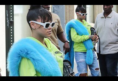 Rihanna steps out in ripped denim and fuzzy blue boa