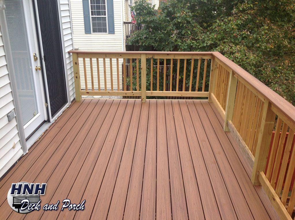 Composite deck using trexcompany transcend tiki torch for Composite flooring for decks