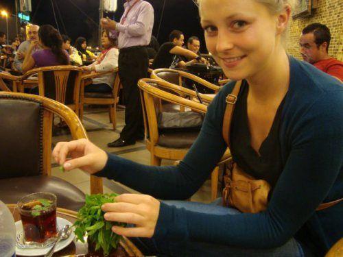 Carolyn puts mint into her #tea in Alexandria. Image via theculturalsponge.wordpress.com.