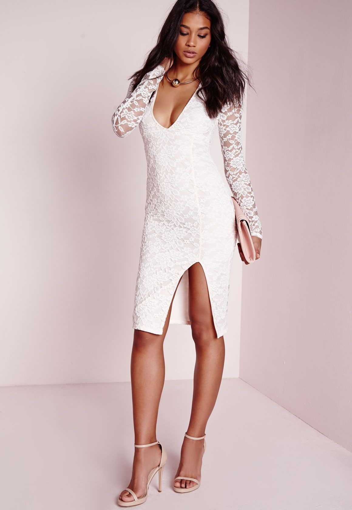 Lavish in lace in this romantic style midi dress this party season. With seriously sexy figure flattering nude fabric with white lace over lay, you can ensure all eyes are on you at the party. The plunge v-neck feature , long lace sleeves a...