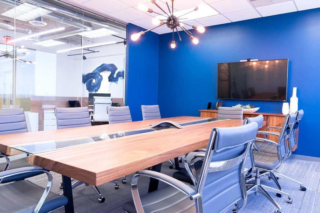 Cool Office Conference Room With Bright Blue Walls A Live Edge Wood Table And Modern Branch Ligh Conference Room Design Blue Wall Colors Live Edge Wood Table