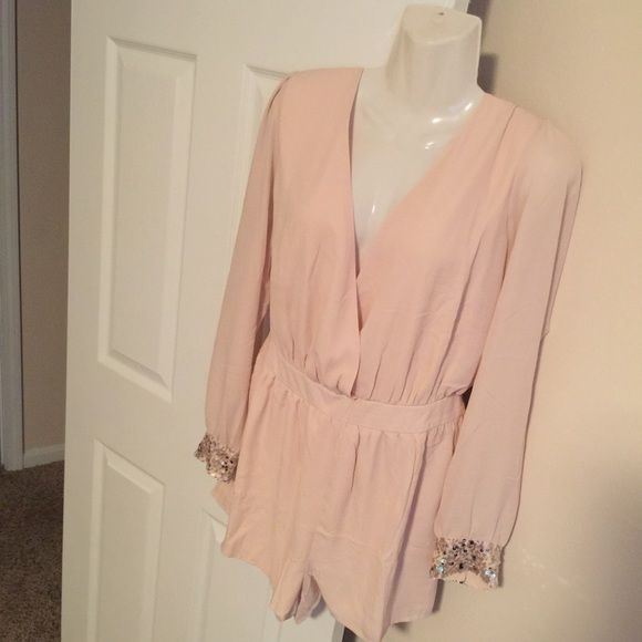 Blush Romper NWOT. Run true to size.. Can't model because they don't fit. No trades, pp or other apps. Use the offer app. Don't ask the lowest. Fair offers please. Elastic waist. Forever 21 Other