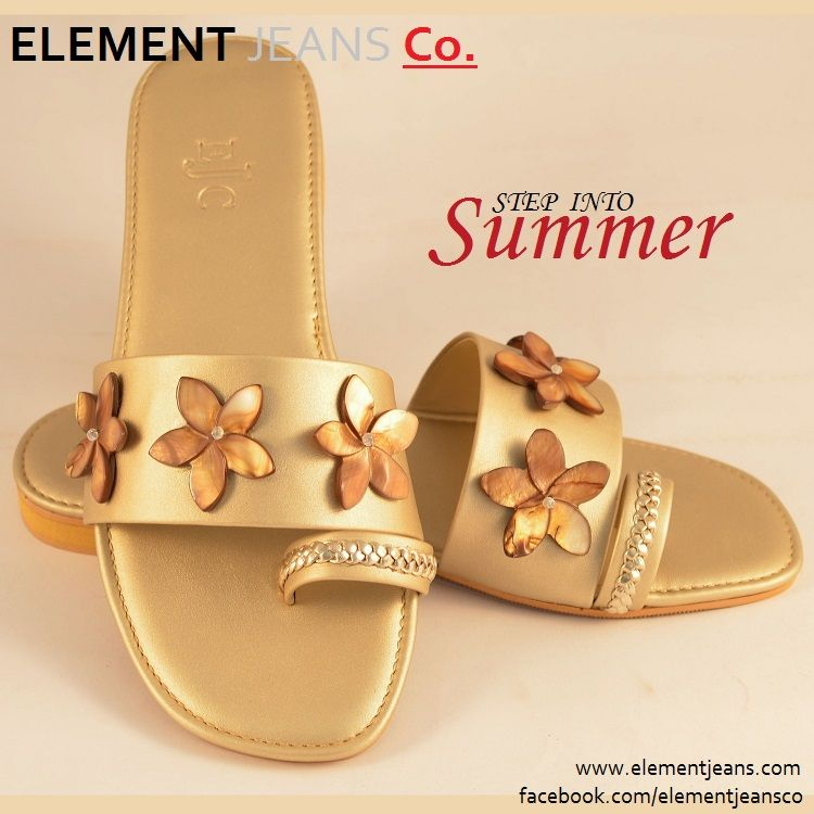 A Dull Gold Flat Slippers Embellished With Wooden Flowers