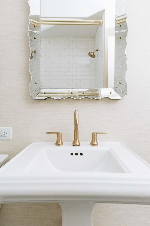 White And Tan Bathroom With Scalloped Mirror Features A White
