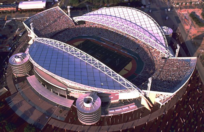 When it was built, Sydney's Stadium Australia (now ANZ Stadium) was the largest Olympic Stadium ever built, with a capacity for 114,000. It was built with sustainability in mind, with far less steel usage than Athens' Olympic Stadium or Beijing's Bird's Nest.