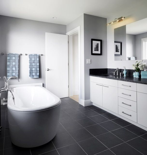 Have The White Vanity With Black Top Option Dark Tile Floor Lighter Around Tub And Shower