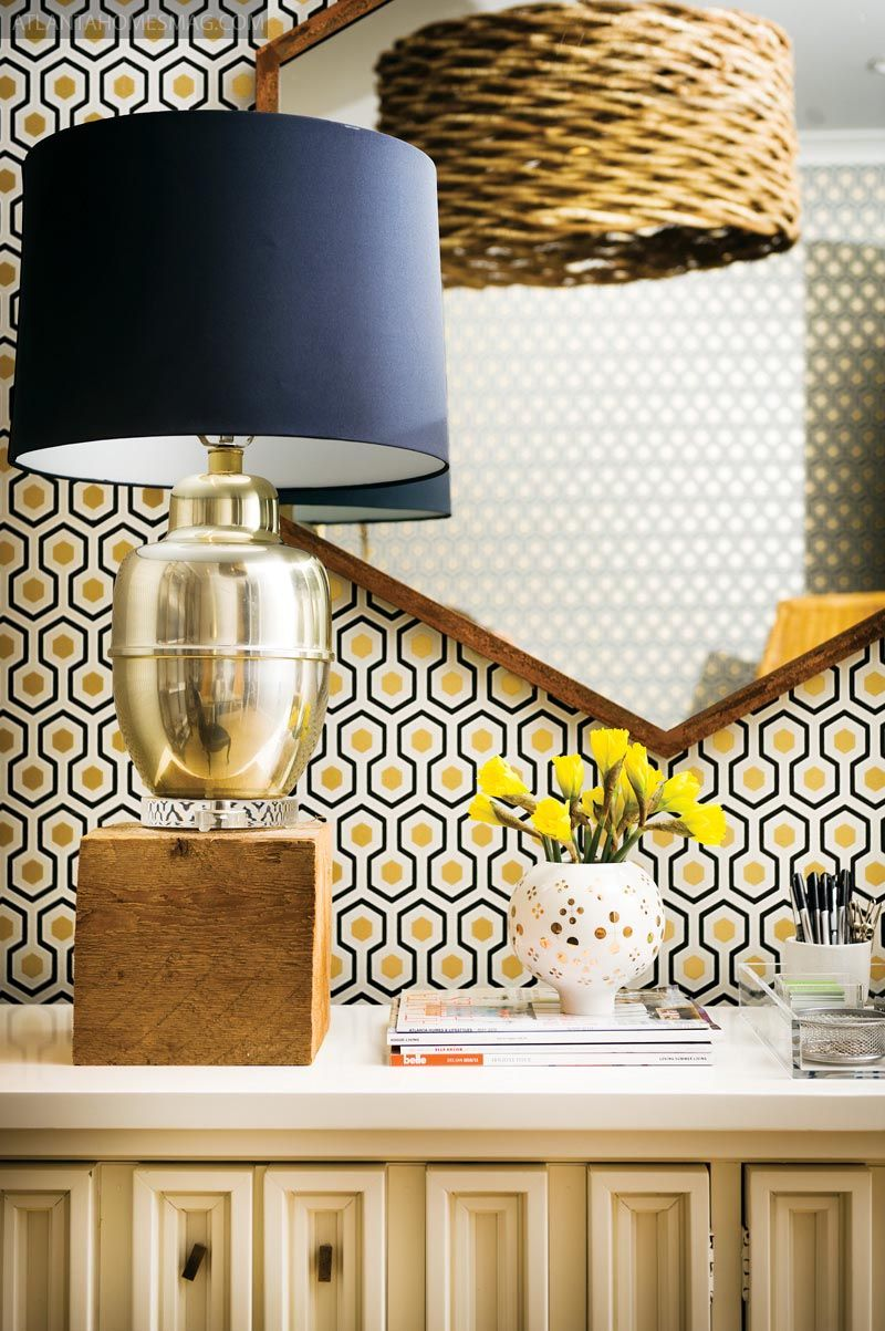 Gold lamp, black shade.  Love Hicks wallpaper, too.
