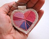 Embroidered heart ornament in pinks and purples for Valentine's Day. $35.00, via Etsy.