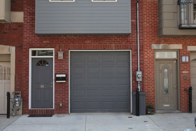 Grey doors on red brick. Trim colour is much lighter than brick grout | Red brick house, Brick ...