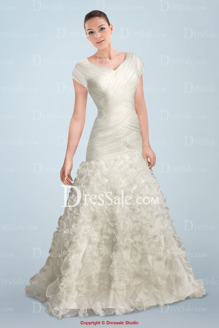Smashing short sleeve mermaid bridal dress featuring intricate