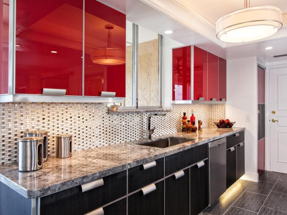 jill green of sand castle designs used a bright glossy red for the upper cabinets