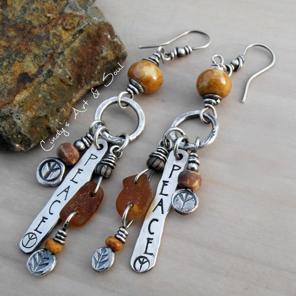 The new Bohemian. Peace earrings featuring handmade ceramic beads and hand stamped charms.