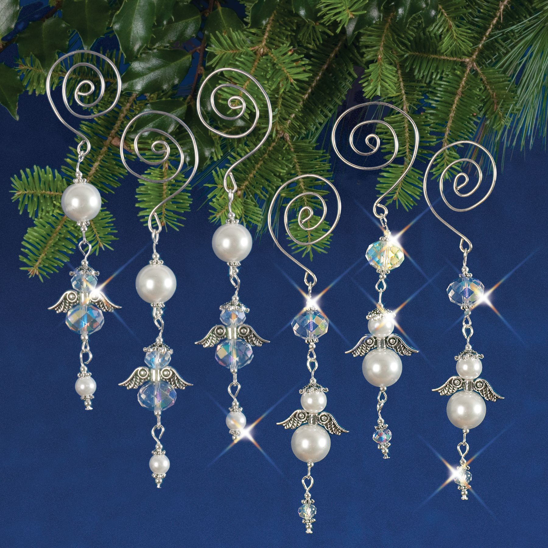 Dangling Angels made with sparkling faceted crystals, creamy satin glass pearls and glistening silver components and wire. Each kit make 6 dangling angels, 3 each of two designs.