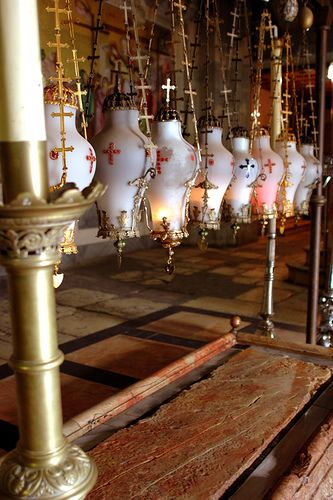 The Stone of Anointing, also known as The Stone of Unction, which tradition claims to be the spot where Jesus' body was prepared for burial by Joseph of Arimathea - www.JulianLacey.com Julian Lacey (CC) Julian Lacey www.julianlacey.com