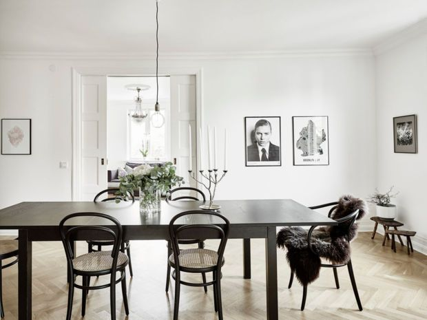 Black and white never fails. The refined details of this modern arrangement evoke an essence of modern simplicity and stylish flair. A lone sheepskin draped atop the dining chair lends a much-needed textured accent to the set.
