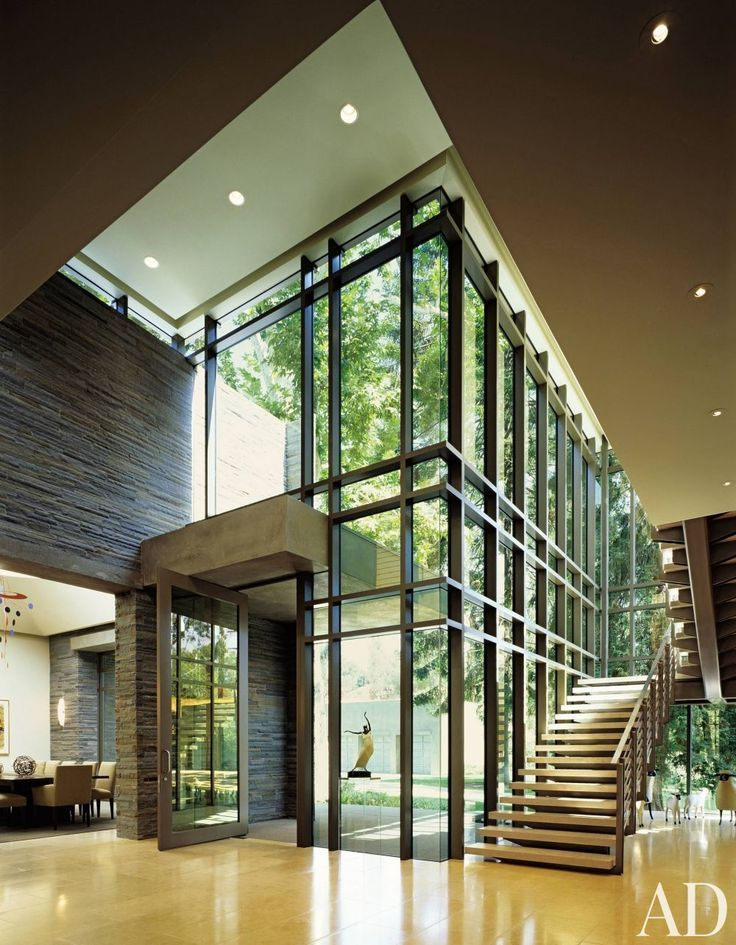 Double height contemporary entrance hall google search for Modern architectural interior designs