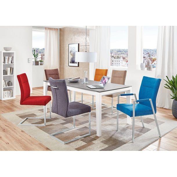 Bei dem sehr modern in Erscheinung tretenden Stuhl QBIS handelt es sich um einen angesagten Stuhl mit Armlehnen, welcher Ihnen aufgrund seiner Formgebung perfektes Sitzen ermöglicht.<br/>Seine elegante Kolorierung lässt ihn in vorhandenem Interieur optimal zur Geltung kommen.<br/><br/>Die Basis für den Stuhl QBIS bildet ein formschönes Edelstahlgestell, das im unteren Bereich für optimalen Stand sorgt und oben einer ergonomisch geformten Sitzfläche Halt gibt. <br/>Der Armlehenstuhl geht in eine