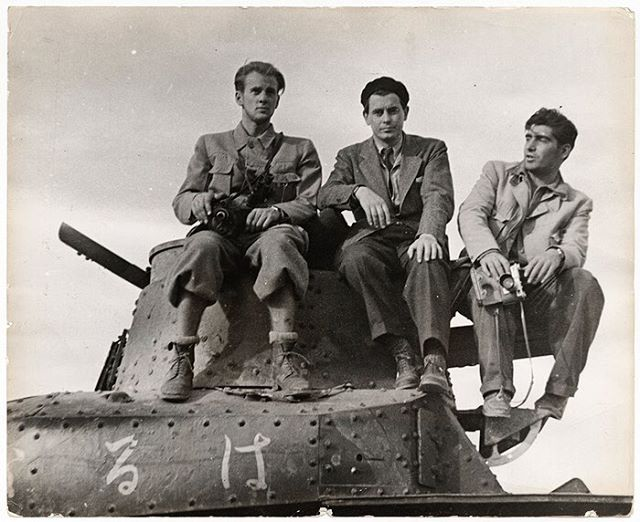 John Fernhout, Joris Ivens, and Robert Capa on a Japanese tank captured at the Battle of Tai'erzhuang in China. #ICPCollections  Unidentified Photographer, April 1938