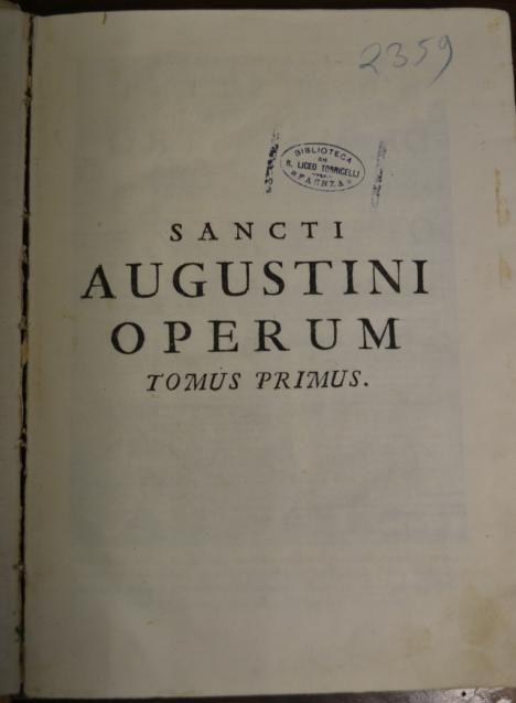 Sancti Augustini Operum. Notare il timbro: Biblioteca del R. Liceo Torricelli Faenza.