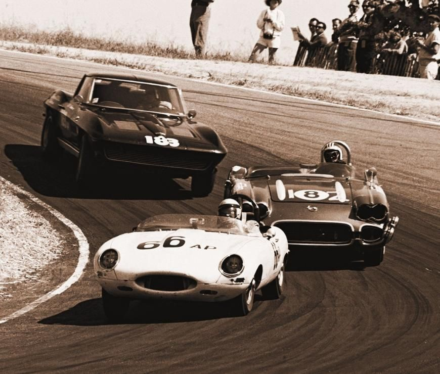 Jaguar E Type - ''At Laguna Seca, Merle Brennan leads the solid-axle Corvette roadster of Jerry Hansen and the Sting Ray coupe of Bill Sherwood coming down through the Corkscrew. This was at a race for production classes that was a preliminary to the 1963 USRRC round,