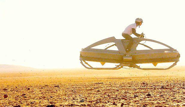 Just centimetres above the ground, the Aeroflex hover bike flies over desert