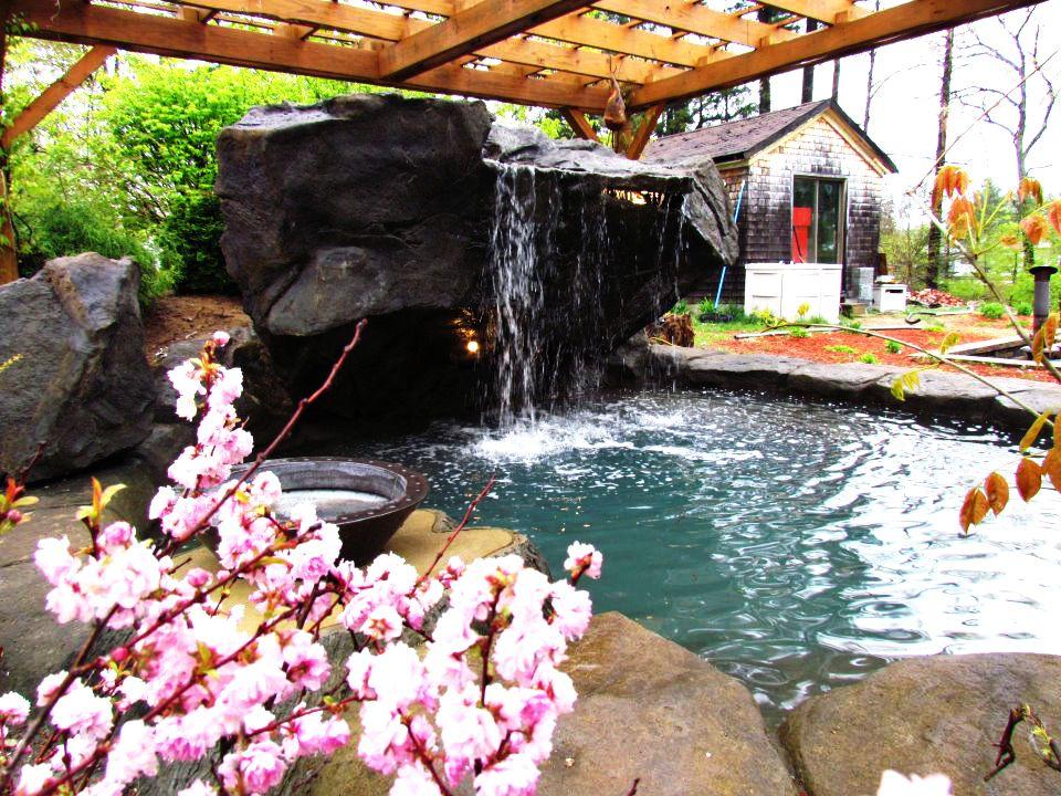 Poolside waterfall #pool #waterfall #water #poolside Swimming