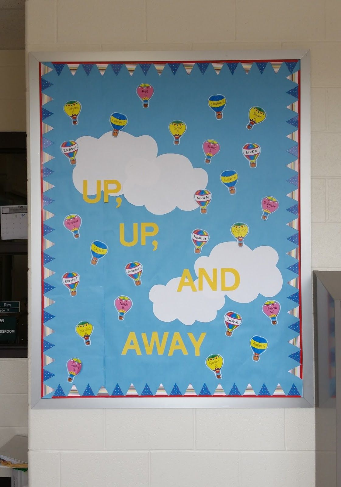 up up and away bulletin board with hot air balloons and