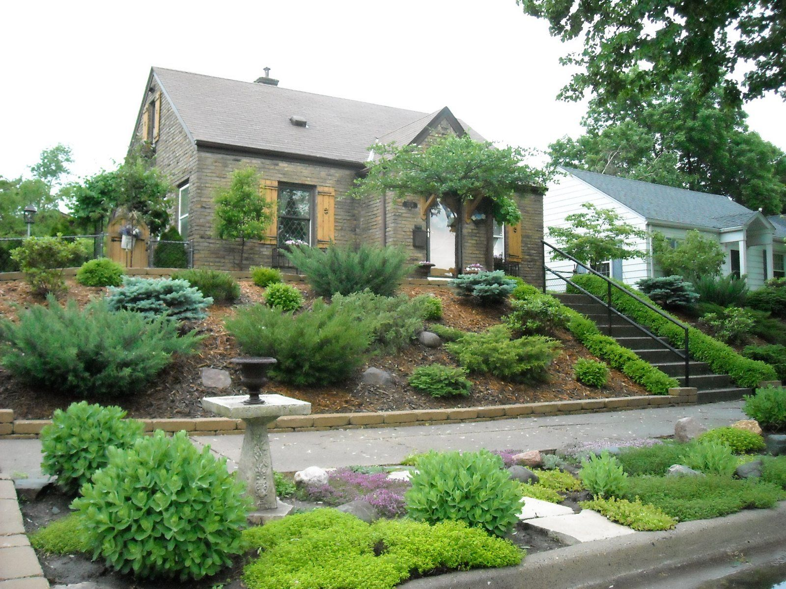 Hill Landscaping Ideas | transitional shot of the front yard ...