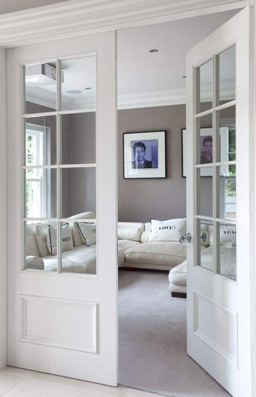 make a pocket door like this and put photographs over. Black Bedroom Furniture Sets. Home Design Ideas