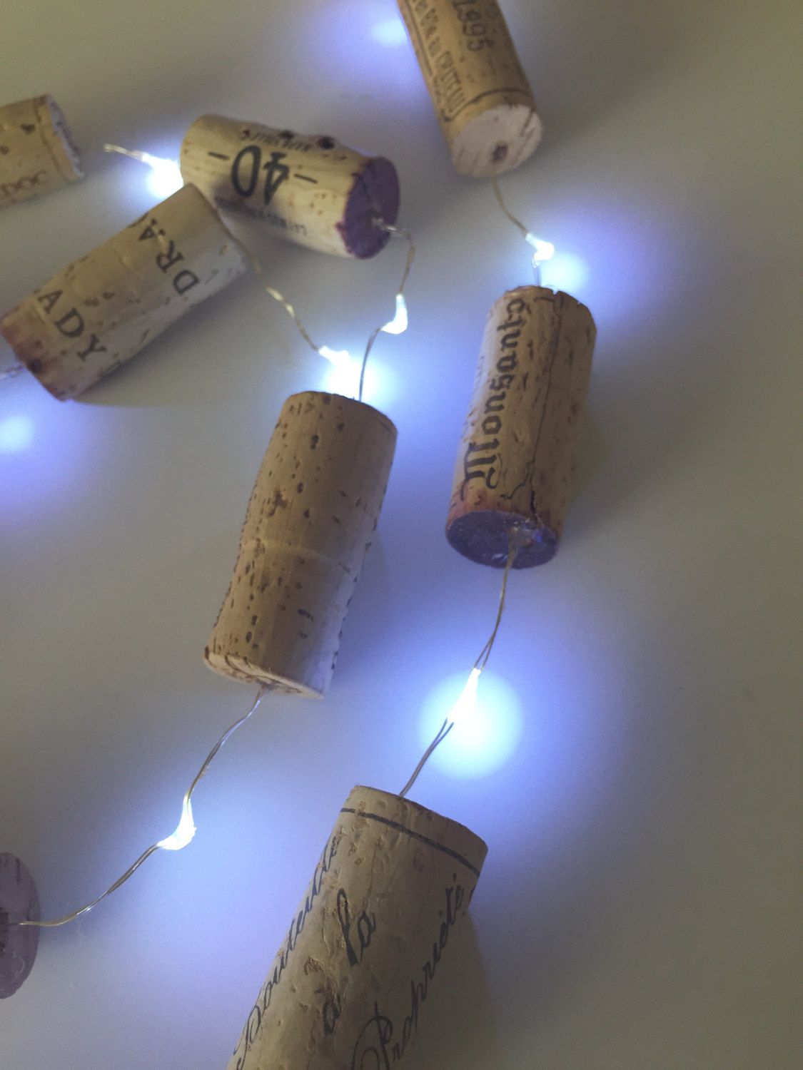 This unique christmas light, string lights and christmas garland would be a nice add to your christmas tree. These cute wine cork garland can be used for wedding decor also. This garland is great for wedding decoration or a wine gift.  Check out all of wine themed gifts.  WINE-CG-Light  Garland Length : 7 feet I am a huge wine lover, and you may be also...so why not a wine themed garland ? WE SHIP DAILY, JUST IN TIME FOR THAT SPECIAL SOMEONE!!!  Garland is 7 feet long. Made from used wine…