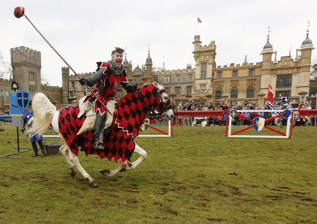 A performer dressed as a medievel knight shows off jousting skills at Knebworth House in Hertfordshire, UK, April 1, 2013. Knebworth House, a stately home of the Lytton family since 1490, hosted The Knights Of Royal England in their first medievel jousting tournament of the season. (Photo by Olivia Harris/Reuters)