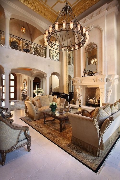 Traditional Living Room With Barbara Cosgrove Floral Mirror In Gold, Cement  Fireplace, High Ceiling, Area Rug, Arched Doorway