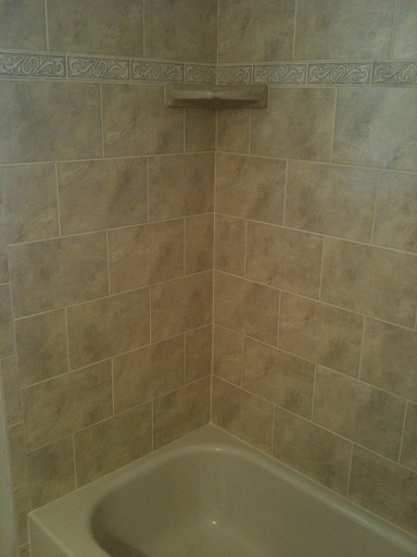 8x12 Porcelain Tile With 2x8 Listello Deco Fl Vines Shower Installation In Brandon
