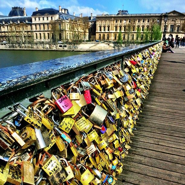 Pont des Arts: FREE. 1st metal bridge created during Napoléonic reign. Padlocks added to railing w/ names on them and keys thrown into river below to signify commitment to each other (watch for police patrolling to keep people from throwing keys into river).