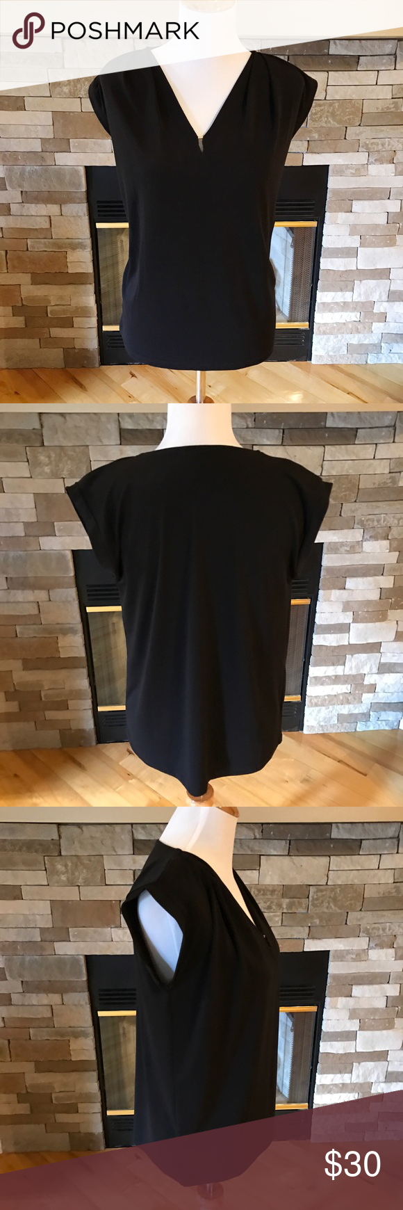 Ann Taylor Black Cap Sleeve Top Dressy Ann Taylor black cap sleeve top with gold accent piece at the neckline.  In very good condition, only worn a couple of times. Size small, 96% Polyester, 4% Spandex. Ann Taylor Tops Blouses