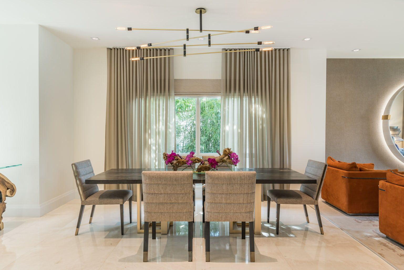 Adding a modern light fixture to a transitional space ...