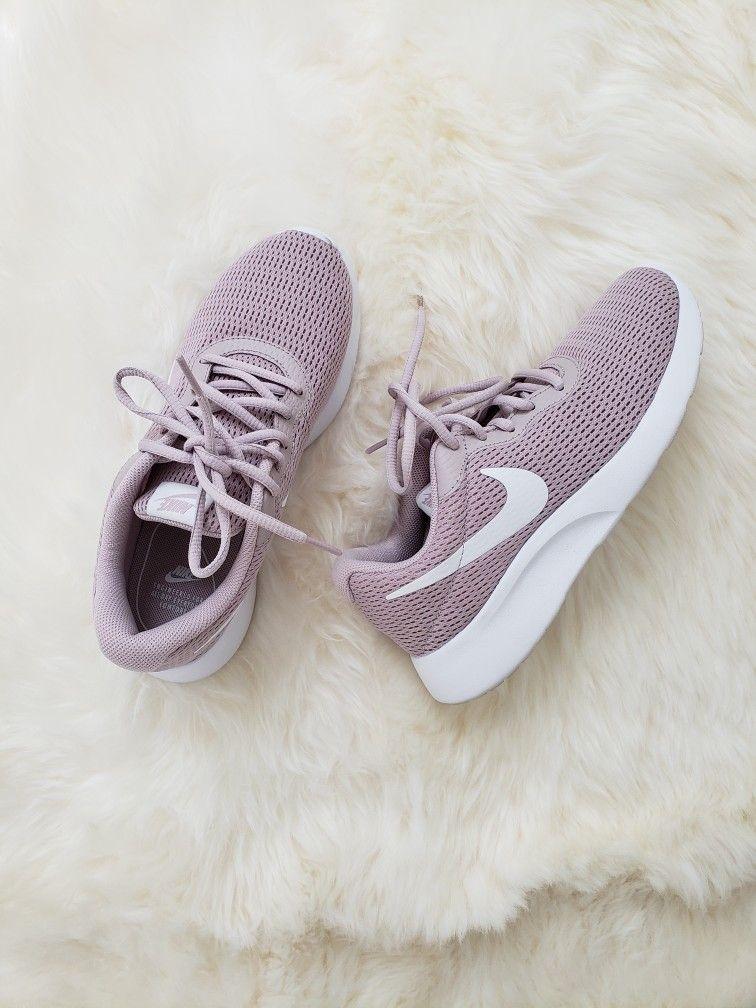 Rose gold metallic Nike Tanjun sneaker