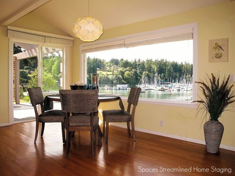 Imagine eating in this staged dining area with beautiful view...
