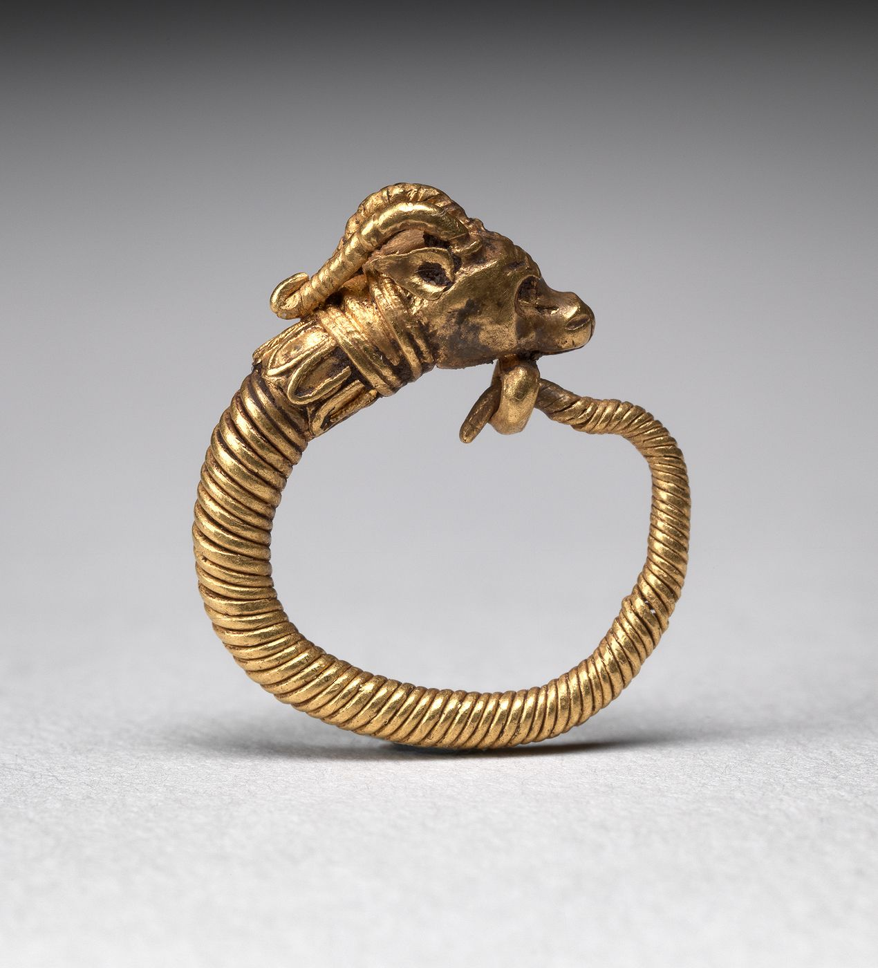 Early Egyptian Earring: The god Amun was often portrayed as a ram and both were associated with creativity and virility. Earrings were worn by men and women, both in life and after death, and were made in many different shapes, using a variety of materials.