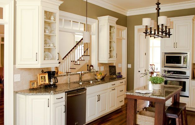 Executive painted cream latte kitchen cabinets home for Cream kitchen paint ideas