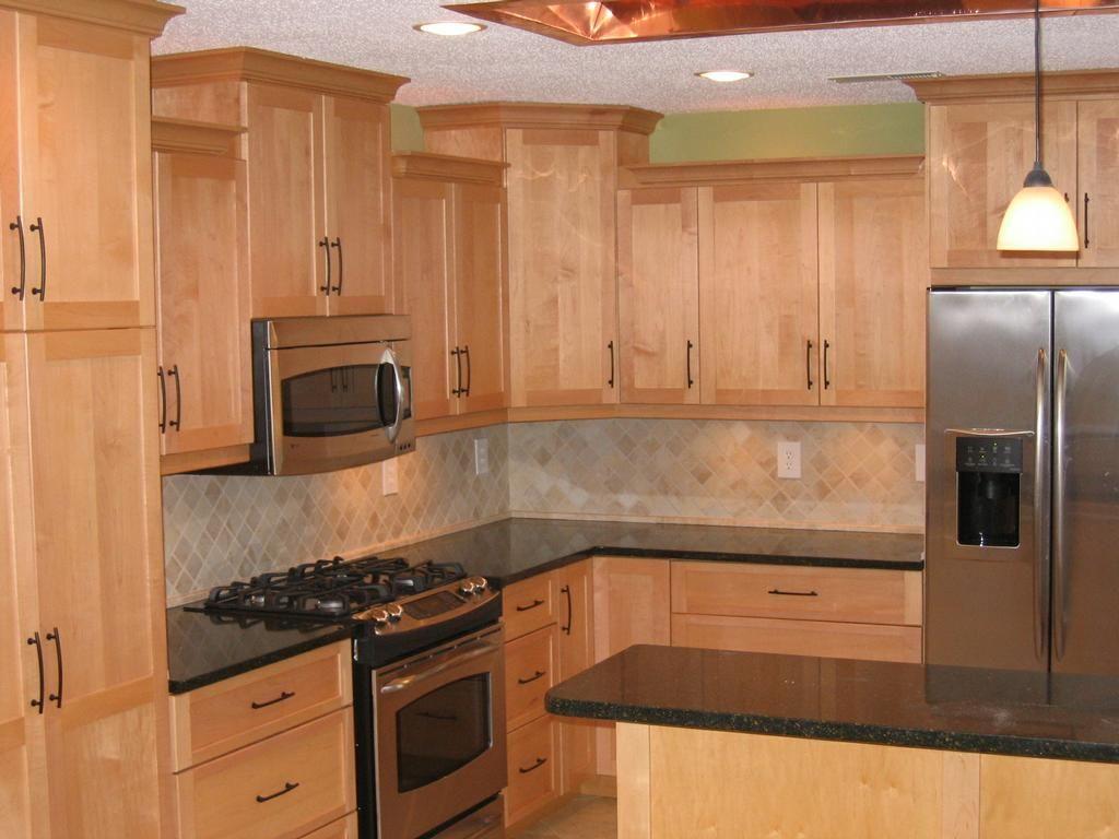 image result for black granite maple cabinets backsplash
