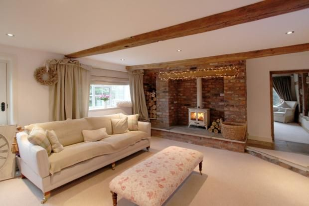 Cream woodburner, Inglenook fireplace and wood storage - I love this Living Room