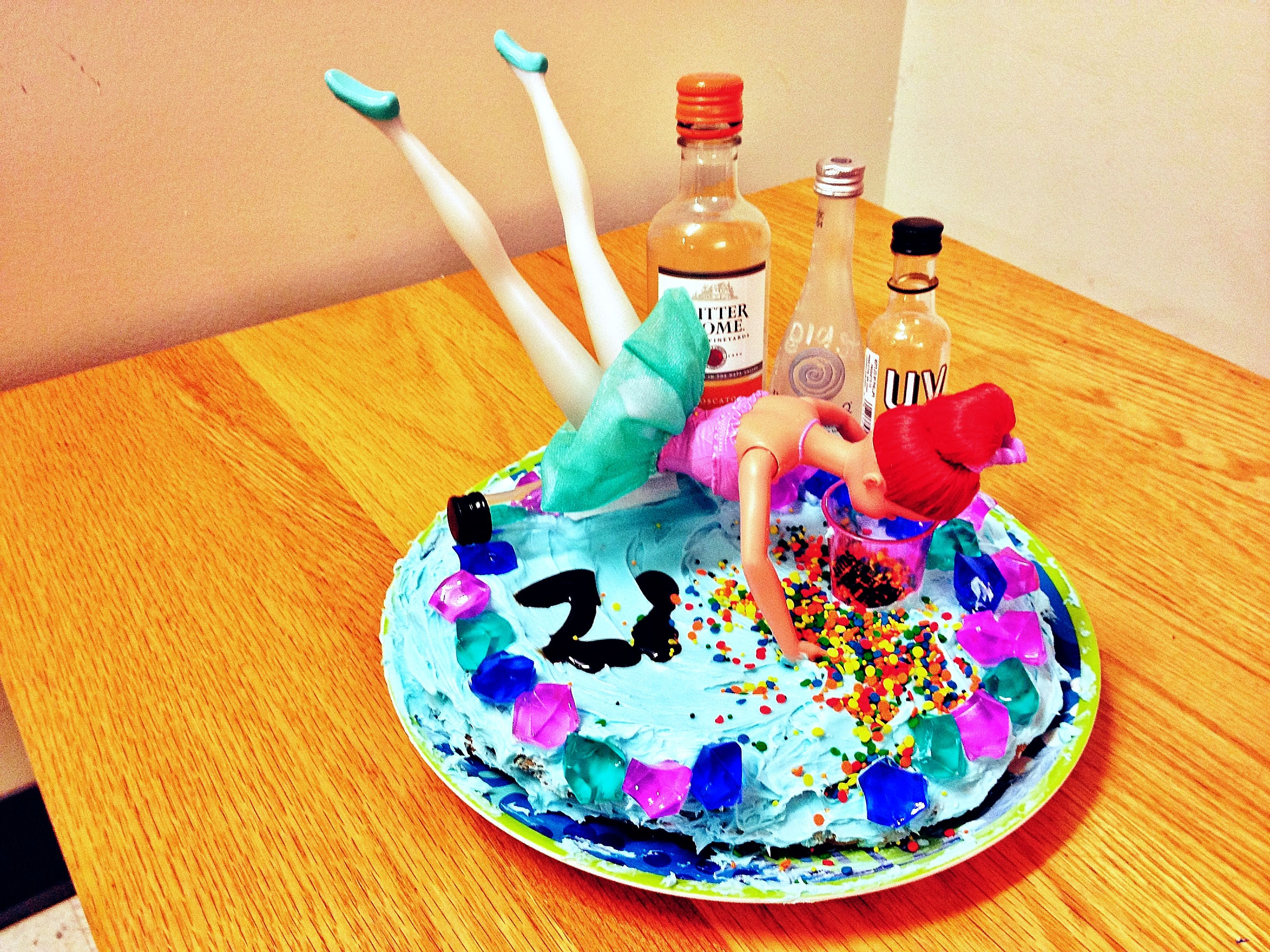 My 22nd birthday cake with a drunk Ariel lol Birthday Shenanigan