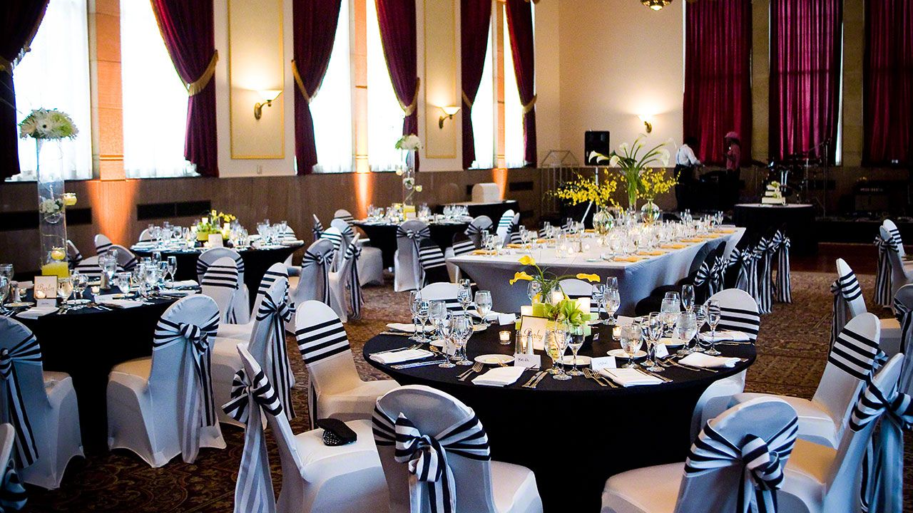 Black and white theme with spandex chair covers and striped sashes. #fabulousevents #weloveuglychairs #chaircovers #linenrental #linenrentals #chaircoverrental