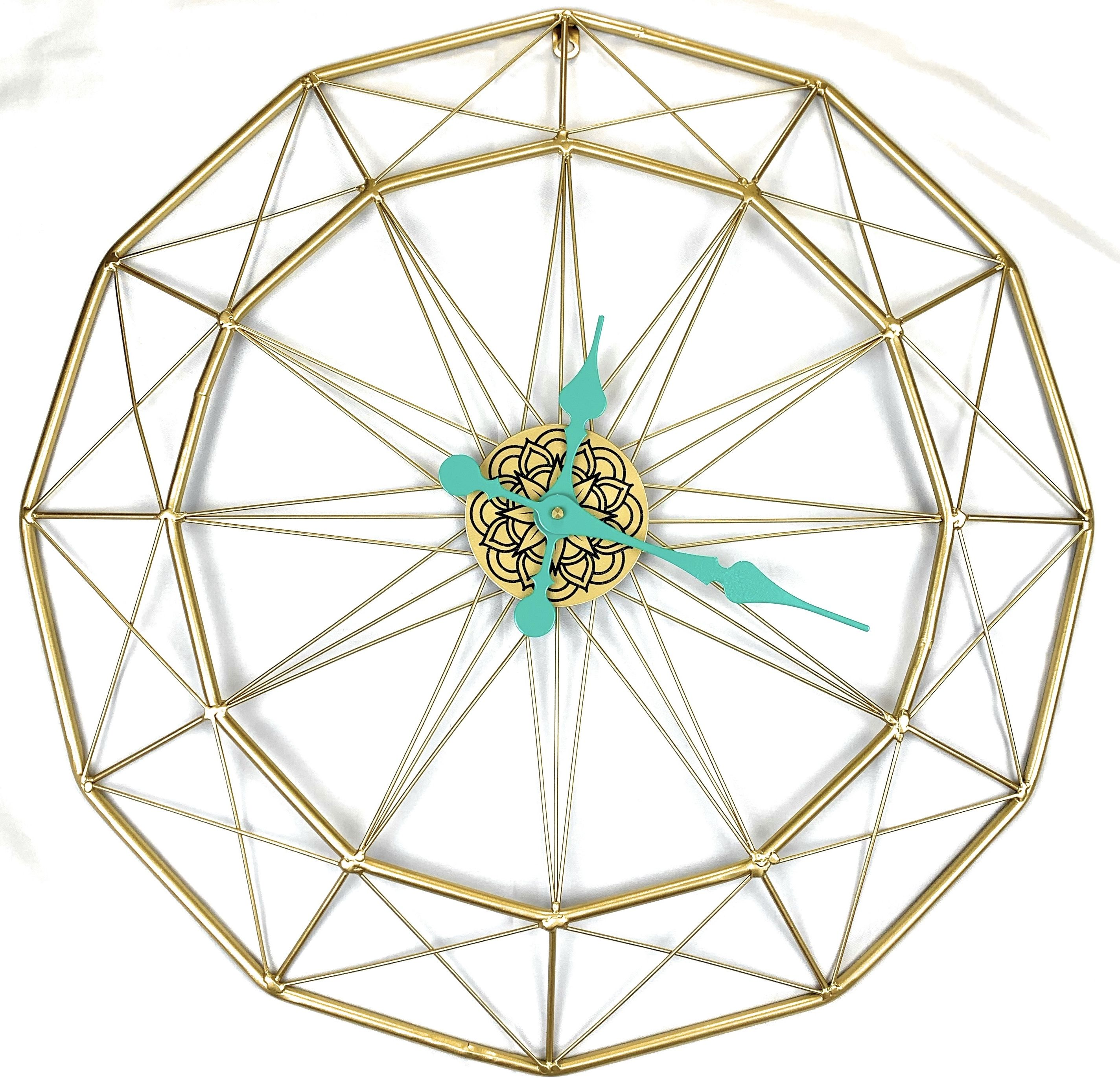 A Large 22 Inch Gold Wire Wall Clock With A Floral