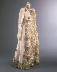Woman's Evening Coat  Made in Paris, France, Europe Fall 1939  Designed by Elsa Schiaparelli, French (born Italy), 1890 - 1973. Embroidered by Lesage, Paris, founded 1922.  Silk faille, gold embroidery Center Front Length: 54 inches (137.2 cm)