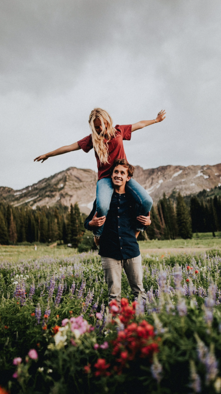 Tell the birds. Engagement mountain photo, flower fields.