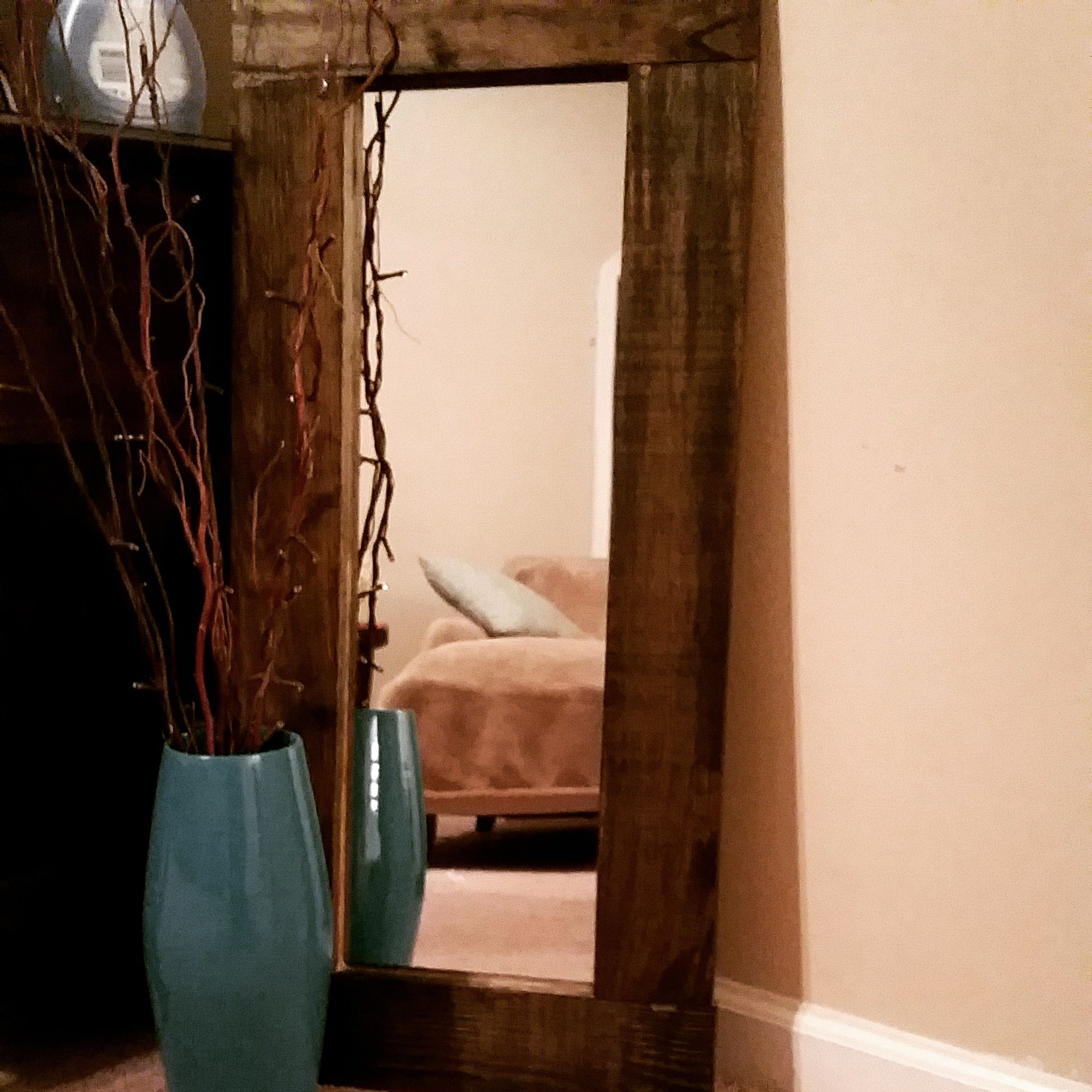 Wooden mirror frame made with $5 mirror from Walmart, Lowes or Target.