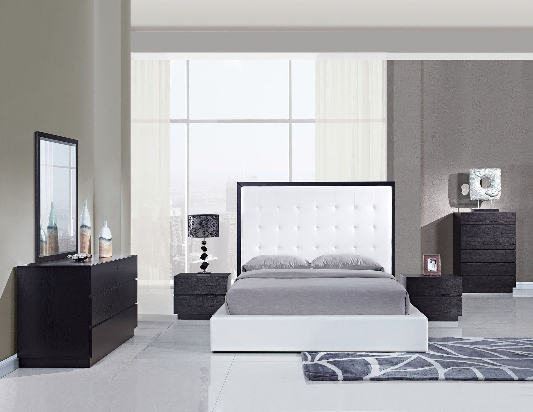 Metro White Bedroom Set is part of White bedroom Set - The Metro Bedroom Collection is made of all oak wood veneers finished in wenge  The grand headboard and footboards are finished in a crisp white leatherette  This collection will provide a city living feel to any home    Set includes Bed (Queen or King size), 2 Nightstands, Dresser, and Mirror  Chest is available sepa