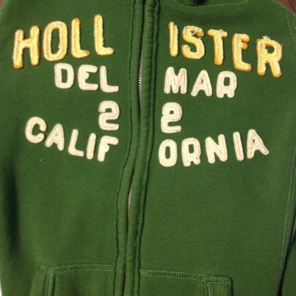 Hollister Zip-Up Jacket Gently used. Forest green zip up jacket. Great for fall. Letters on the front are in a darker yellow. Has a hood, but with out the hood strings. Two pockets on the front. No stains or rips. Bundle for a discount!  Hollister Jackets & Coats